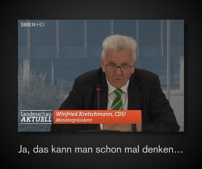 Screenshot 'Landesschau Aktuell' des Südwestfunks, Kretschmann redet, dazu eine Einblendung: 'Winfried Kretschmann, CDU - Ministerpräsident' -- Text darunter 'Ja, das kann man schon mal denken...'