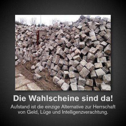 Foto eines Haufens von Pflastersteinen. Darunter der Text: Die Wahlscheine sind da! Aufstand ist die einzige Alternative zur Herrschaft von Geld, Lüge und Intelligenzverachtung.