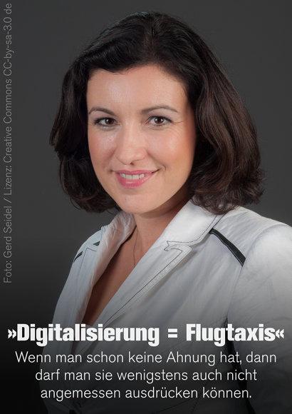 Foto von Dorothee Bär. Darunter der Text: Digitalisierung = Flugtaxis. Wenn man schon keine Ahnung hat, darf man sie wenigstens auch nicht angemessen ausdrücken können.