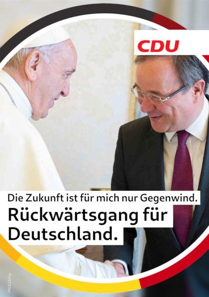 Bild im Stil eines CDU-Wahlplakates zum laufenden Bundestagswahlkampf. Motiv ist Armin Laschet, der dem Papst die Hand schüttelt. Text dazu: Die Zukunft ist für mich nur Gegenwind. Rückwärtsgang für Deutschland.